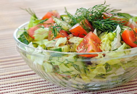 Fresh vegetable salad with tomato, lettuce, cucumber Fresh vegetable salad with tomato, lettuce, cucumber